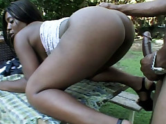 Big ass ebony Brazil enjoys outdoor pussy licking and hard anal pounding from a black dude