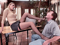 Leggy blonde Darryl Hanah spreading her legs wide to show off her sultry cunt and give off a foot job