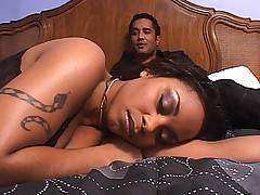 Horny ebony pornstars Lola Lane and Kitten take turns fucking a black dick in this hot threesome