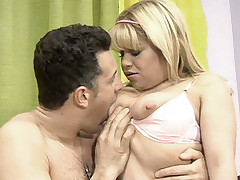Chubby blonde Conie fondles her huge tits while having her pussy licked and lapped