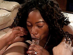 Ebony babe in heat receives a hard pussy pounding from a black stud