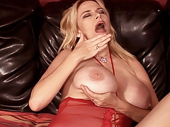 Buxom blonde Lynn Lemay hikes up her sexy nightgown to let this black dude eat out her pussy