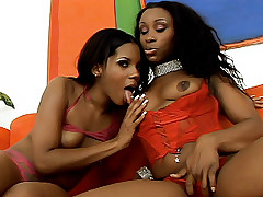 Naughty ebony Kianna Jayde and Strokahontas take turns slobbering eager pussy slits