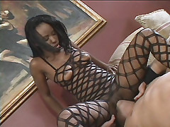 Lady Armani gets a creamy cum facial as this ebony gets fucked hard on the sofa