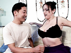 Sexy Milf Moxie Madden teases a younger asian looking guy by showing her heavy knockers