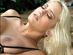 Blonde porn star Trina Michaels enjoys some outdoor loving and ends up with jizz on her face