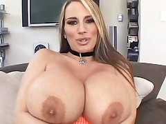 Blonde milf Lisa Lipps showing off her massive set of knockers and gets cock spooned on the couch