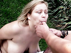 Blonde bbw Helga mashes her tits together as she gets fucked hard outdoors
