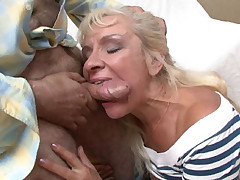 Pretty mature blonde working a big cock with her wrinkled lips and experienced pussy flaps