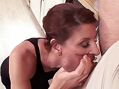 Mature hottie Linda Roberts sits over the kitchen counter getting her pussy tongue fucked