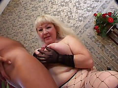Naughty mature blonde with big racks made use of her ample assets to work a stiff cock