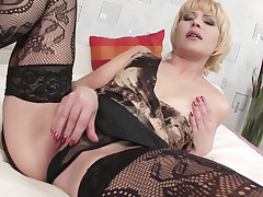 Older babe Ira Filimonova give her young stud a taste of her mature pussy while wearing her black lingerie