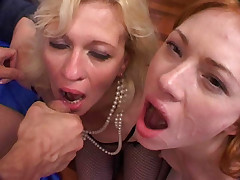 Horny older blonde sharing a big cock with a horny redhead and gets her fair share of cum facial