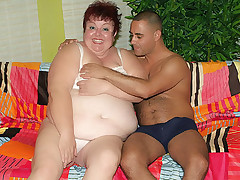Massive redhead BBW Louise spreads her enormous thighs wide to let a hunk eat out and fuck her pussy