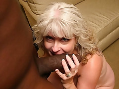 Plump racked mom getting a mouthful of black cock