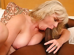 Hot mom pumping her sex holes with black meat stick