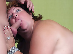 Sherry is a massive redhead working a cock with her mouth and welcomes it in her chubby mound