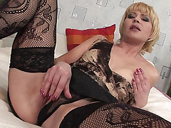 Naughty mature blonde spreads her thighs wide to jill off her clit and take cock pumping on top