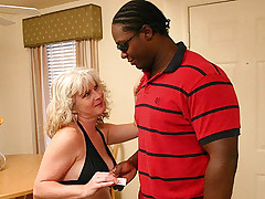 Lusty MILF lets a black hunk bang her pussy