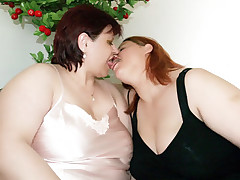 Lesbian plumpers Chaste and Marta start off kissing and end up drilling toys in each others cooters