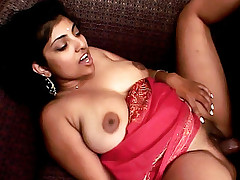 Indian cutie Arhuarya fingers her own wet pussy while sucking on a throbbing dick