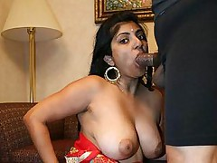 Busty Indian Arhuarya lets her big tits jiggle as she rides out a huge dick in the living room
