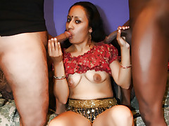 Sexy Ethnic chick Ishu goes to work sucking and fucking in an explicit gang bang movie