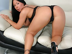 Lucy Love sucks on a huge cock while having her tight ass fucked from below