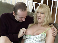 Horny wife Beth Sweetney satisfies her insatiable cooze by hooking up with two younger guys