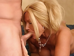 Horny busty MILF enjoy munching on a stiff meat stick