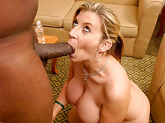 Busty mom sucking on a fat black dick