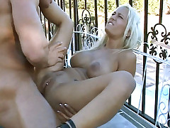 Hot blonde Trina Michaels spreading her butt wide to welcome a huge fat wang in her bumhole