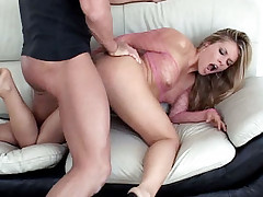 Blonde hottie Kylie bends over the couch so she could have her ass drilled