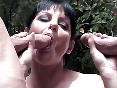 Cock greedy pornstar Ariana working two enormous dongs with her mouth and tiny butthole