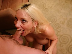 Horny MILF filling her cunt and mouth with cock