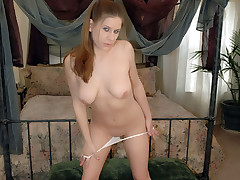 Blonde newcomer Mandy stripping her clothes in her bedroom to show us her moist looking panties