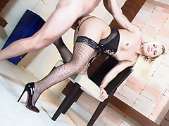 Blonde babe Thais Schiavinato struts her sexy stocking clad thighs and gets her asshole screwed