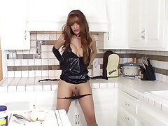 Busty shemale Giselle stroking her pipe in the kitchen and unloading it into a hotdog sandwich