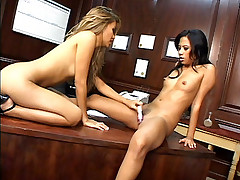 Asian lesbians Nyomi Marcela and Lana Croft pleasure each other doing a sixty nine position in an office table