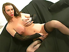 Shemale gets a mouthful of cock on her knees